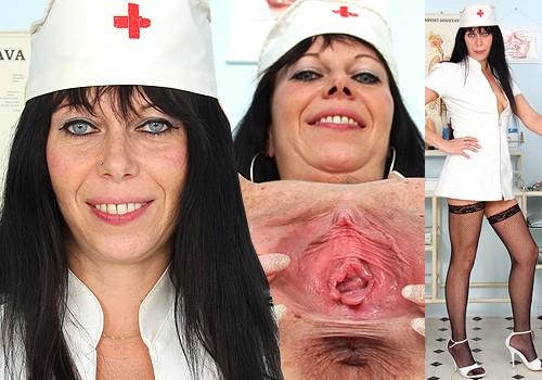 Ma'am Brunette Registered practical nurse Smiles and Shows Twat in Hosiery and Steep Heels